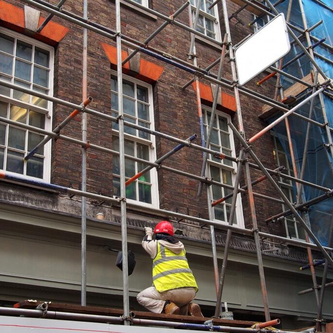 a worker on the scaffolding